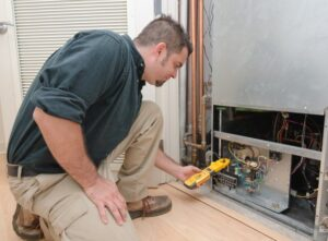 A technician conducting an HVAC tune-up in Murfreesboro